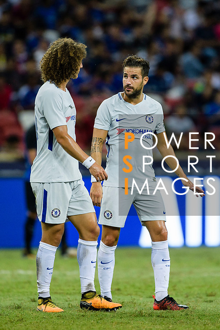Chelsea Midfielder Cesc Fabregas (R) speaks to teammate David Luiz during the International Champions Cup 2017 match between FC Internazionale and Chelsea FC on July 29, 2017 in Singapore. Photo by Weixiang Lim / Power Sport Images
