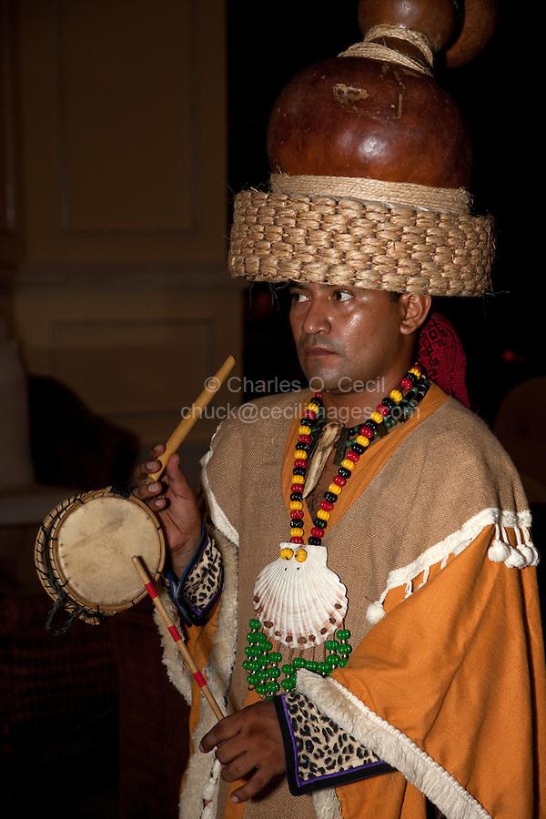 Mayan in Traditional Pre-Hispanic Costume Playing Traditional Drum,  Playa del Carmen, Riviera Maya, Yucatan, Mexico.
