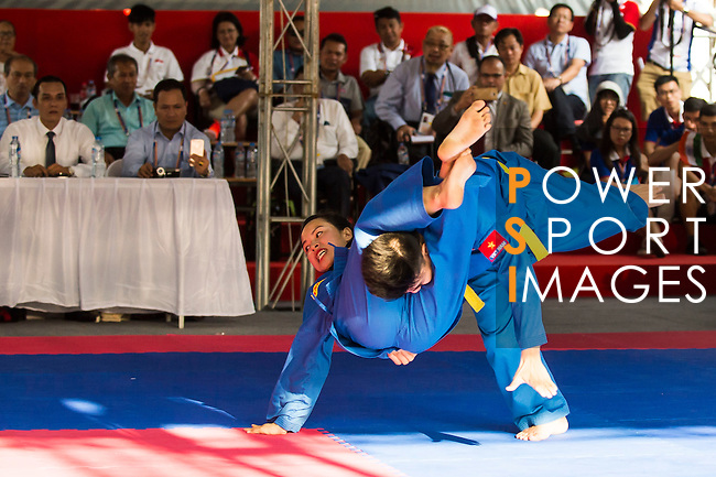 NGUYEN THI HOAI Nuong and NGUYEN HOANG du of Vietnam in action during the Vovinam Mixed Events Self-defense for Women on Day Eight of the 5th Asian Beach Games 2016 at Bien Dong Park on 01 October 2016, in Danang, Vietnam. Photo by Marcio Machado / Power Sport Images