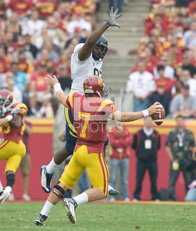Cameron Jordan of California tries to block Matt Barkley of USC during the game at LA Memorial Coliseum in Los Angeles, California.  USC defeated California, 48-14.