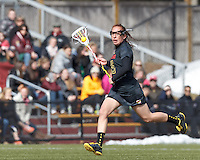University of Maryland defender Melissa Diepold (15) brings the ball forward. .University of Maryland (black) defeated Boston College (white), 13-5, on the Newton Campus Lacrosse Field at Boston College, on March 16, 2013.