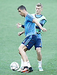 Real Madrid's Cristiano Ronaldo (l) and Toni Kroos during Champions League 2015/2016 training session. May 27,2016. (ALTERPHOTOS/Acero)