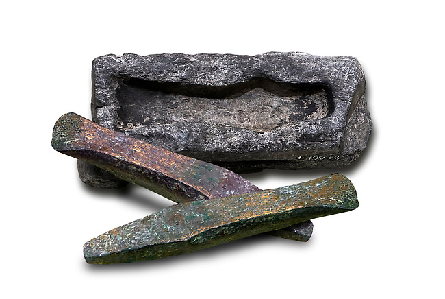 Hittite axe head mould and bronze axe heads. Hittite Period 1600 - 1200 BC. Alaca Hoyuk. Çorum Archaeological Museum, Corum, Turkey. Against a white bacground.