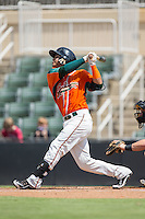 Angel Reyes (30) of the Greensboro Grasshoppers follows through on his swing against the Kannapolis Intimidators at Intimidators Stadium on July 17, 2016 in Greensboro, North Carolina.  The Intimidators defeated the Grasshoppers 3-2 in game one of a double-header.  (Brian Westerholt/Four Seam Images)