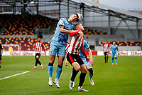 17th October 2020; Brentford Community Stadium, London, England; English Football League Championship Football, Brentford FC versus Coventry City; Michael Rose of Coventry City wins the header from Sergi Canos of Brentford