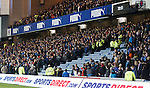 Police clear fans from a section of the stadium due to some structural problems with the roof of the Govan Stand