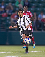 Rochester Rhinos midfielder Alfonso Motagalvan (5) passes the ball. In a Third Round U.S. Open Cup match, the Chicago Fire defeated the Rochester Rhinos, 1-0, at Sahlens Stadium on June 28, 2011.