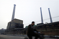 A cyclist passes the Shenyang Smelter, one of the most important comprehensive enterprises producing heavy nonferrous metals in China. The smelter was declared bankrupt in 2000, and a decision was recently made to raze it..20-JAN-02