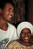 Bahia, Brazil. Smiling man and woman in white headdress.