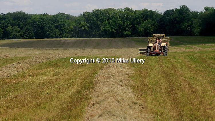 Frank Grilliot of Russia and Leroy Ahrns of Ft. Loramie bale hay at the Johnston Farm in Piqua, Ohio.