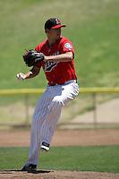 Austin Hudson #25 of the High Desert Mavericks pitches against the Visalia Rawhide at Stater Bros. Stadium on May 16, 2012 in Adelanto,California. (Larry Goren/Four Seam Images)
