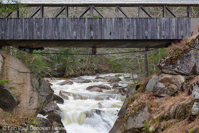"""Sentinel Pine Covered Bridge in Franconia Notch State Park of Lincoln, New Hampshire during the spring months. This footbridge crosses over the Pemigewasset River just above """"The Pool""""."""