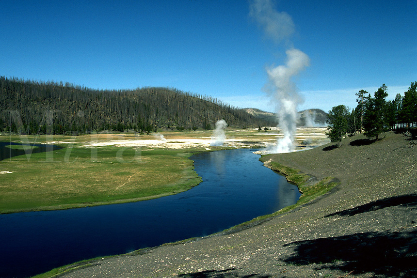 Firehole River with geyser in Yellowstone National Park. Wyoming, Yellowstone National Park.