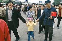 China. Province of Beijing. Beijing. Tiananmen Square. A chinese family, three generations (grandfather, son and granddaughter), in the crowd on the feast of the first of may. Just one child as part as the one child policy for families by government decision  © 2004 Didier Ruef