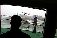 CHINA. Chongqing Province.  Men travelling down the Yangtze. The flooding of the three Gorges, by damming the Yangtze near the town of YiChang, has remained a controversial subject due to the negative environmental consequences and the displacement of millions of people in the flood plain. The Yangtze River however is reported to be at its lowest level in 150 years as a result of a country-wide drought. It is China's longest river and the third longest in the world. Originating in Tibet, the river flows for 3,964 miles (6,380km) through central China into the East China Sea at Shanghai.  2008.