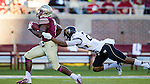 Wake Forest cornerback Brad Watson makes a diving tackle on FSU's Mario Pender after a 56 yard gain in the fourth quarter when Florida State defeated Wake Forest 43-3 in an NCAA football game in Tallahassee, FL October 4, 2014.
