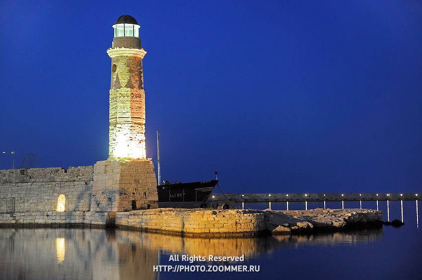 Lighthouse in the night in Rethymno port, Crete
