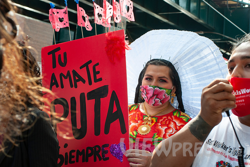 NEW YORK, QUEENS - NY SEPTEMBER 18: A protester chanting slogans on a megaphone and the protesters holding a banner saying love yourself sexworker during the demonstration against discrimination of sex work held on 18 September, 2020 in Jackson Heights,Queens,New York. <br />  (Photo by Joana Toro /VIEWpress)