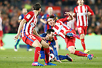 FC Barcelona's Leo Messi (c) and Atletico de Madrid's Juanfran Torres (l) and Filipe Luis during Spanish Kings Cup semifinal 2nd leg match. February 07,2017. (ALTERPHOTOS/Acero)