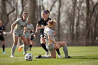 LOUISVILLE, KY - MARCH 13: Emily Fox #11 of Racing Louisville FC passes the ball past the legs of Julianne Vallerand #26 of West Virginia University during a game between West Virginia University and Racing Louisville FC at Thurman Hutchins Park on March 13, 2021 in Louisville, Kentucky.