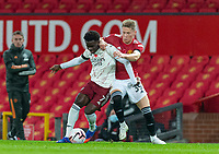 1st November 2020, Old Trafford, Manchester, England;  Arsenal s Bukayo Saka is challenged by Manchester Uniteds Scott McTominay during the English Premier League match between Manchester United FC and Arsenal FC at Old Trafford