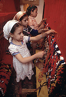 In Fez, Morocco, by tradion in a very early age, the girls are trained to make carpets. Child labor as seen around the world between 1979 and 1980 - Photographer Jean Pierre Laffont, touched by the suffering of child workers, chronicled their plight in 12 countries over the course of one year.  Laffont was awarded The World Press Award and Madeline Ross Award among many others for his work.