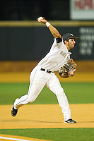 Third baseman Carlos Lopez #3 of the Wake Forest Demon Deacons makes a throw to first base against the Charlotte 49ers at Gene Hooks Field on March 22, 2011 in Winston-Salem, North Carolina.   Photo by Brian Westerholt / Four Seam Images