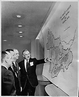 le PM ontarien John Robarts discute des grand lacs, 1964<br /> <br /> Water shortage sparks conference. Ontario's Premier John Robarts points to map of Great Lakes at the conference of Ontario; Quebec and eight states called to discuss the water shortage in the lakes. With him are; from left; Rene Levesque of Quebec; Governor Otto Kerner of Illinois and Governor Matthew E. Welsh of Indiana. 1964<br /> <br /> PHOTO :  Dick Darrell - Toronto Star Archives - AQP