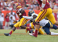 September 22, 2012: California's Josh Hill strips the ball out of USC's Curits McNeal during a game at the Los Angeles Memorial Coliseum, Los Angeles, Ca  USC defeated California 27- 9