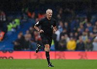 2nd October 2021; Stamford Bridge, Chelsea, London, England; Premier League football Chelsea versus Southampton; Referee Martin Atkinson running to the VAR system