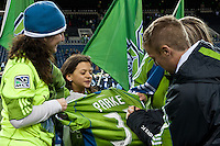 Jeff Parke of the Seattle Sounders gives a fan the shirt off his back after the Sounders defeated Chivas USA 2-1 at the XBox 360 Pitch at Quest Field in Seattle, WA on October 15, 2010.