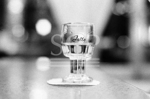 Czech Republic. Jalta vodka shot glass on table in a cafe.