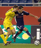 Clint Dempsey brings the ball down the wing as Manny Lagos defends. New England Revolution defeat Columbus Crew, 3-0 at Gillette Stadium on April 9, 2005.