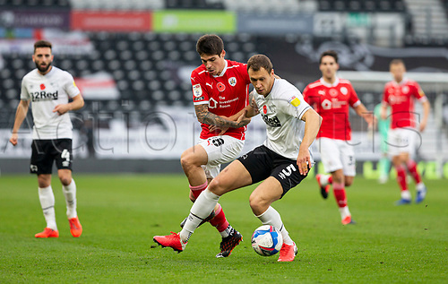 7th November 2020; Pride Park, Derby, East Midlands; English Football League Championship Football, Derby County versus Barnsley; Krystian Bielik of Derby County with the ball at his feet as Dominik Frieser of Barnsley challenges