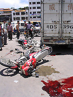 The scene of an accident in Shantau, Guangdong, China. The number of traffic accidents in China is escalating as the number of bad drivers on the road increases.
