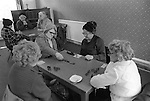 Saltaire near Shipley Bradford West Yorkshire England 1981. Seniors playing game of dominoes in oap centre. World Heritage Site