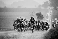 Lars Bak (DEN/Lotto-Belisol) & Ji Cheng (CHN/Giant-Shimano) drive the peleton through a full blown thunderstorm<br /> <br /> 2014 Tour de France<br /> stage 19: Maubourguet - Bergerac (208km)