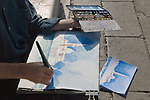 Venice Italy 2009. Pavement artist doing a water colour of the church of San Giorgio Maggiore.