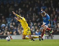 Fleetwood Town's Ched Evans (left) is brought down by Portsmouth's Ross McCrorie (right) tackle<br /> <br /> Photographer David Horton/CameraSport<br /> <br /> The EFL Sky Bet League One - Portsmouth v Fleetwood Town - Tuesday 10th March 2020 - Fratton Park - Portsmouth<br /> <br /> World Copyright © 2020 CameraSport. All rights reserved. 43 Linden Ave. Countesthorpe. Leicester. England. LE8 5PG - Tel: +44 (0) 116 277 4147 - admin@camerasport.com - www.camerasport.com