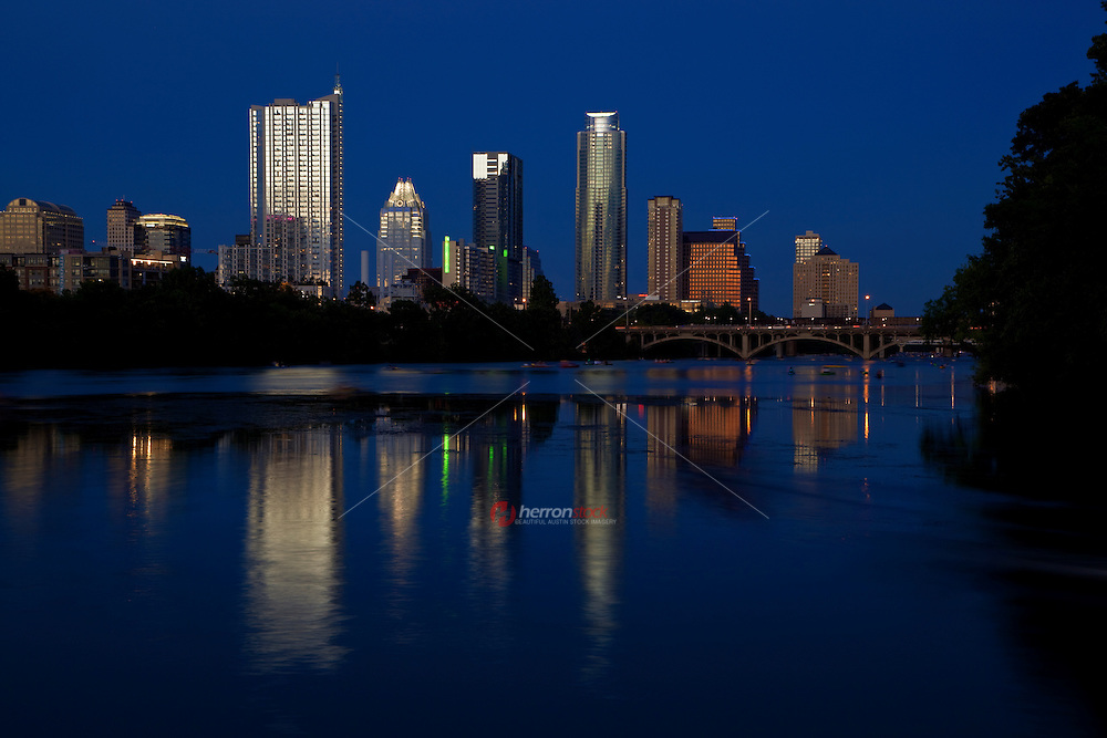Austin, Texas downtown night city skyline reflection on the calm waters of Lady Bird Lake in Austin, Texas.