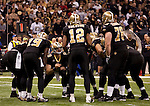 December 2009: New Orleans Saints quarterback Drew Brees (9) calls a play in the huddle during an NFL football game at the Louisiana Superdome in New Orleans.  The Cowboys defeated the Saints 24-17.