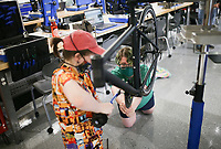 Gentry Dillinger (from left) and Dilynn Swearengin assemble a bike, Thursday, September 9, 2021 at the Northwest Arkansas Community College in Bentonville. The Northwest Arkansas Community College Workforce & Economic Development Division held an open house Aug. 20 for its new Bicycle Technician Lab. In April, the college was awarded a $1,246,864 grant from the Walton Family Charitable Support Foundation. Funding is being used for the phased roll-out of the college's new Bicycle Assembly and Repair Technician program. Check out nwaonline.com/210910Daily/ for today's photo gallery. <br /> (NWA Democrat-Gazette/Charlie Kaijo)