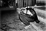 Drugs UK 1980s. Taking drugs  drug addict  glue sniffing teenagers sleeping rough on street of London 80s England She had run away from her family home.
