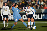 North Carolina Tar Heels forward Casey Nogueira (54) and Notre Dame Fighting Irish defender Haley Ford (8). The North Carolina Tar Heels defeated the Notre Dame Fighting Irish 2-1 during the finals of the NCAA Women's College Cup at Wakemed Soccer Park in Cary, NC, on December 7, 2008. Photo by Howard C. Smith/isiphotos.com