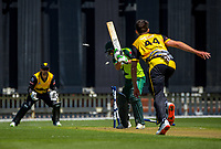 Wellington's Jamie Gibson bowls Pakistan captain Rohail Nazir during the t20 cricket match between the Wellington Firebirds and Pakistan at Basin Reserve in Wellington, New Zealand on Tuesday, 29 December 2020. Photo: Dave Lintott / lintottphoto.co.nz
