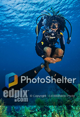 9 June 2015: Divetech SCUBA Divemaster C.J. Powell, from West Bay, hovers over the coral reef at Spanish Bay Reef, on the North Shore of Grand Cayman Island. Located in the British West Indies in the Caribbean, the Cayman Islands are renowned for excellent scuba diving, snorkeling, beaches and banking.  Mandatory Credit: Ed Wolfstein Photo *** RAW (NEF) Image File Available ***