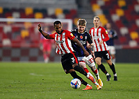 7th November 2020; Brentford Community Stadium, London, England; English Football League Championship Football, Brentford FC versus Middlesbrough; Rico Henry of Brentford being challenged by Hayden Coulson of Middlesbrough