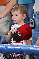 Batavia Muckdogs young fan during the 7th inning stretch during a game vs. the Auburn Doubledays at Dwyer Stadium in Batavia, New York July 3, 2010.   Auburn defeated Batavia 4-0.  Photo By Mike Janes/Four Seam Images