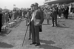 Derby Day 1970. Wealthy couple watching the runners in the Members Enclosure at the Derby