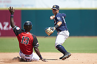 Charleston RiverDogs shortstop Wilkerman Garcia (24) forces out Sherten Apostel (13) of the Hickory Crawdads at L.P. Frans Stadium on May 13, 2019 in Hickory, North Carolina. The Crawdads defeated the RiverDogs 7-5. (Brian Westerholt/Four Seam Images)